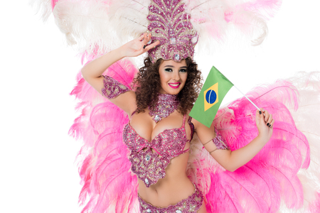 Foto de smiling woman in carnival costume holding brazilian fllag in hand with hand on forehead, isolated on white - Imagen libre de derechos
