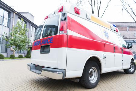 Foto de ambulance white and red car on street - Imagen libre de derechos
