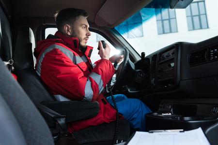 Foto für young handsome male paramedic talking by portable radio - Lizenzfreies Bild
