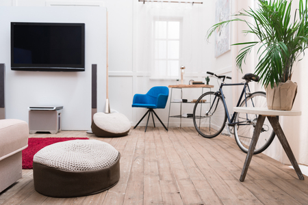 Photo for Interior of living room with TV and bicycle - Royalty Free Image