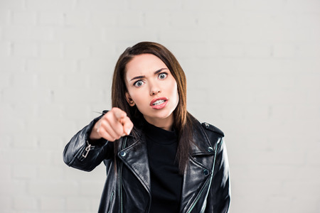 Photo for Angry woman quarreling and pointing on something - Royalty Free Image