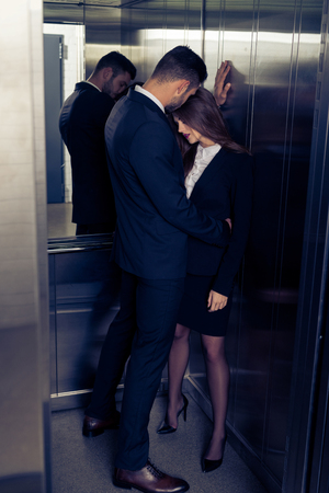Photo for sensual attractive business couple in elevator - Royalty Free Image