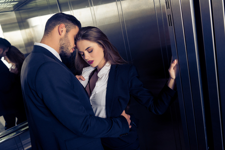 Foto de sensual business couple undressing in elevator - Imagen libre de derechos