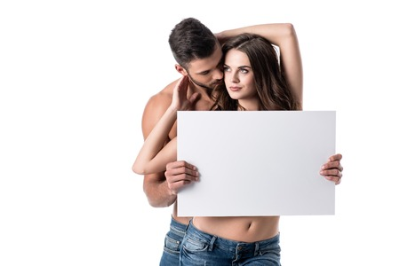 Photo pour young sensual couple in jeans with blank board isolated on white - image libre de droit