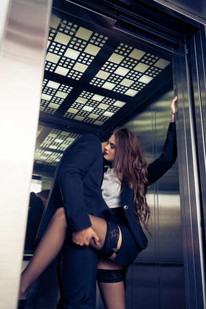 Photo for sensual young business couple in elevator - Royalty Free Image