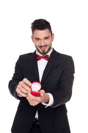 Photo pour handsome man showing red box with marriage rings isolated on white - image libre de droit