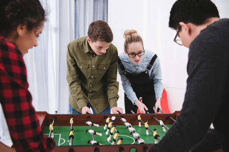 Photo for happy cheerful teenagers playing in table soccer - Royalty Free Image