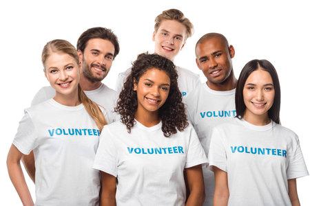 Foto de happy multiethnic group of volunteers isolated on white - Imagen libre de derechos