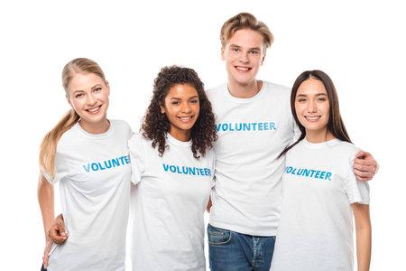 Foto de group of young embracing volunteers isolated on white - Imagen libre de derechos