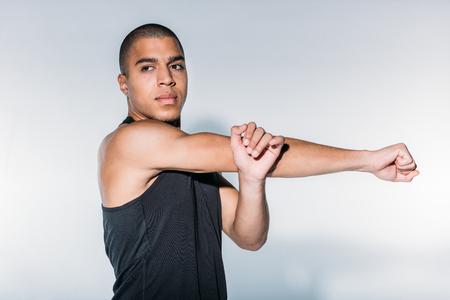 Photo pour african american sportive man stretching hands - image libre de droit