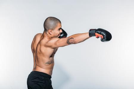 Photo pour african american sportsman boxing on white - image libre de droit