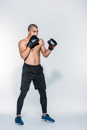 Photo pour muscular african american boxer training on white - image libre de droit