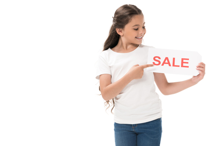 Photo pour portrait of smiling kid pointing at sale banner in hand isolated on white - image libre de droit