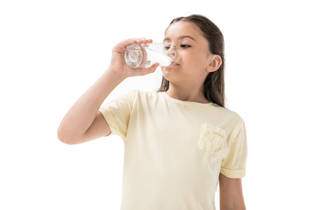 Photo pour portrait of little child drinking water from glass isolated on white - image libre de droit