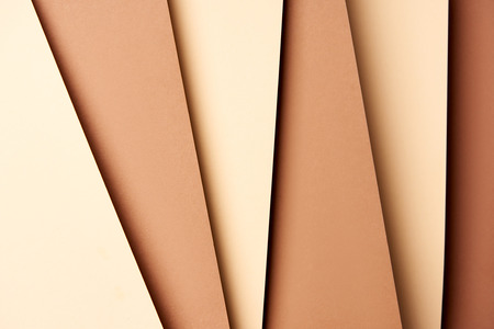 Photo pour Pattern of overlapping paper sheets in beige and brown tones - image libre de droit