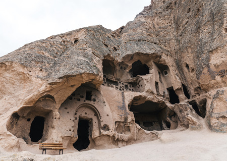 Foto de low angle view of majestic caves in limestone at famous cappadocia, turkey - Imagen libre de derechos
