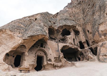 Photo pour low angle view of majestic caves in limestone at famous cappadocia, turkey - image libre de droit
