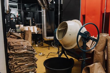 Foto de Interior of coffee production workshop with industrial equipment and packaging - Imagen libre de derechos