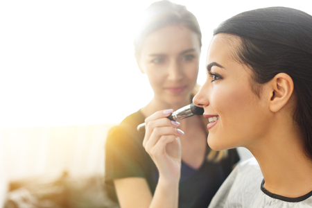 Photo for selective focus of makeup artist applying powder on womans face with brush - Royalty Free Image