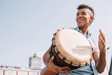 Photo for Hipster african american street drummer performing outdoors - Royalty Free Image