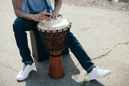 Photo for Cropped view of African american man with djembe performing on street - Royalty Free Image