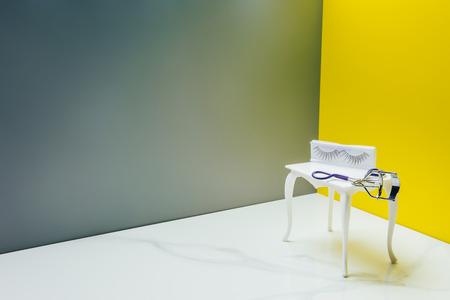 Photo pour dressing table and eyelash curler in miniature room - image libre de droit