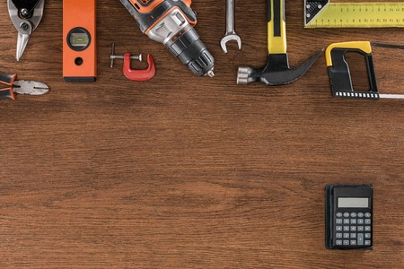 Photo pour top view of arranged various tools and calculator on wooden table - image libre de droit