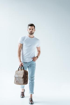 Foto de Fashionable confident man carrying briefcase on white background - Imagen libre de derechos