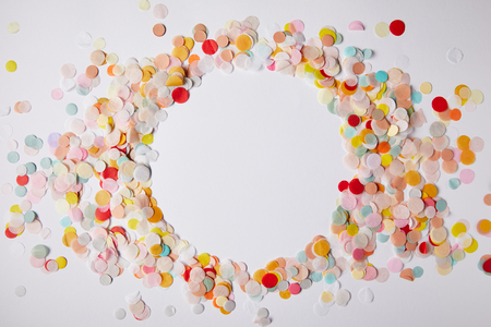 Photo for top view of circle of colored confetti pieces on white surface - Royalty Free Image