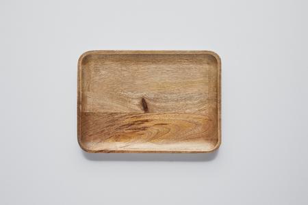 Foto de top view of wooden tray on white table, minimalistic concept - Imagen libre de derechos