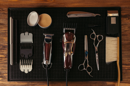 Photo for top view of set of various professional barber tools in hair salon - Royalty Free Image