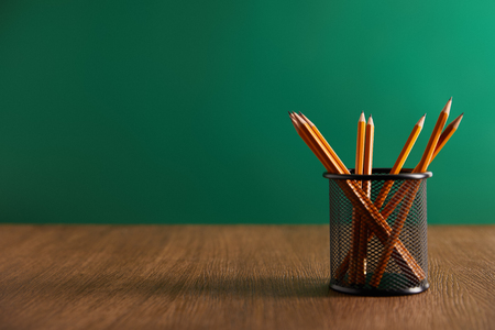 Photo pour pencils on wooden table with green chalkboard on background - image libre de droit