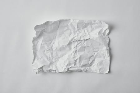 Foto de top view of blank crumpled paper on white surface - Imagen libre de derechos