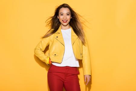 Photo pour young asian female model posing on yellow background - image libre de droit