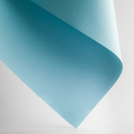 Foto de colored blue paper sheet on grey background - Imagen libre de derechos