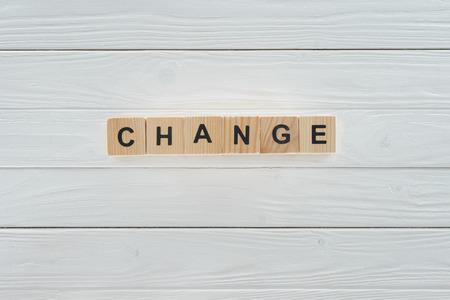 Foto de close up view of change word made of wooden cubes on white wooden tabletop - Imagen libre de derechos