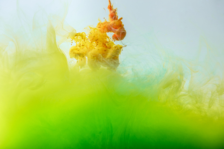Photo for artistic design with flowing yellow and green ink - Royalty Free Image