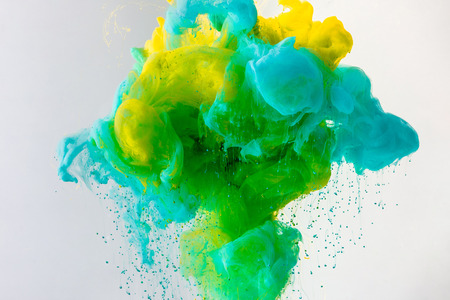 Photo for wallpaper with flowing turquoise, yellow and green paint in water, isolated on grey - Royalty Free Image