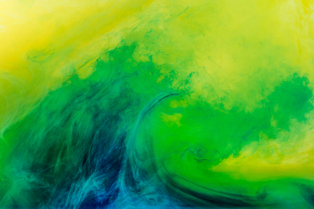 Photo for abstract background with green paint flowing in yellow water - Royalty Free Image
