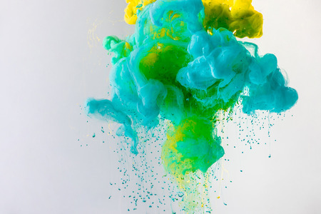 Photo for background with flowing turquoise, yellow and green smoke, isolated on grey - Royalty Free Image