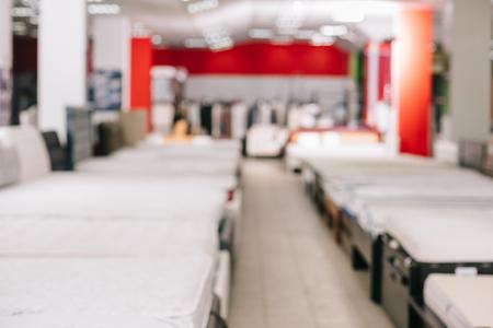 Photo pour interior of furniture store with arranged mattresses around - image libre de droit