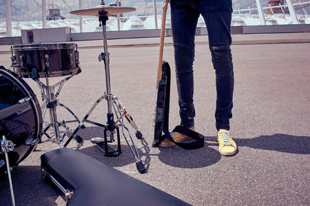 Photo for partial view of musician standing near musical instruments on street - Royalty Free Image