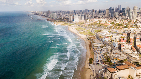 Foto de aerial view of big city with sandy seashore and wavy sea, Tel Aviv, Israel - Imagen libre de derechos