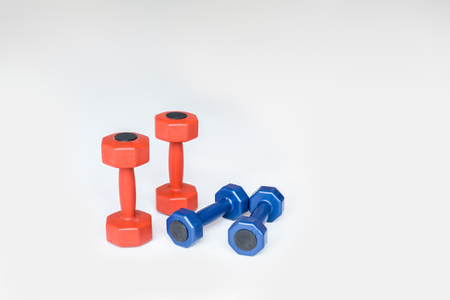 Photo pour close up view of red and blue dumbbells on grey background - image libre de droit