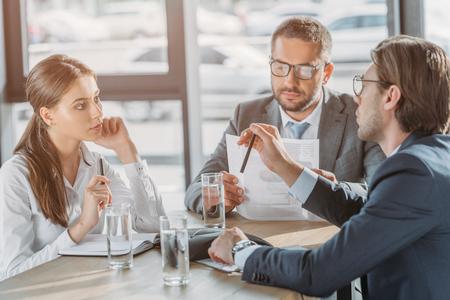 Foto de group of business people with contracts having meeting at modern office - Imagen libre de derechos