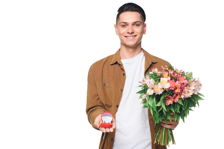 Photo pour happy young man with bouquet making proposal isolated on white - image libre de droit