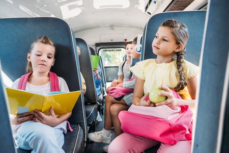 Foto de group of pupils riding on school bus during school excursion - Imagen libre de derechos