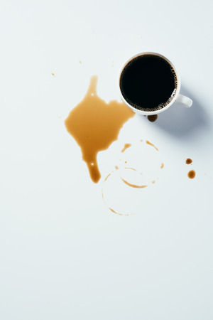 Photo for top view of cup of black coffee standing messy on white surface - Royalty Free Image