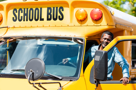 Photo pour handsome senior school bus driver looking at camera - image libre de droit