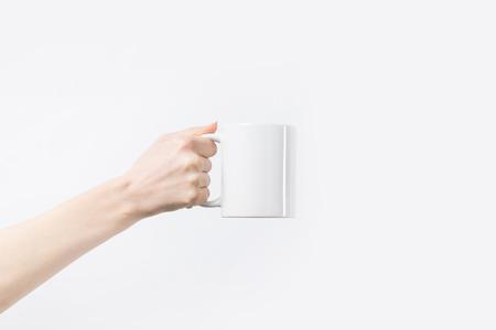 Foto de cropped shot of woman holding white mug in hand isolated on white - Imagen libre de derechos